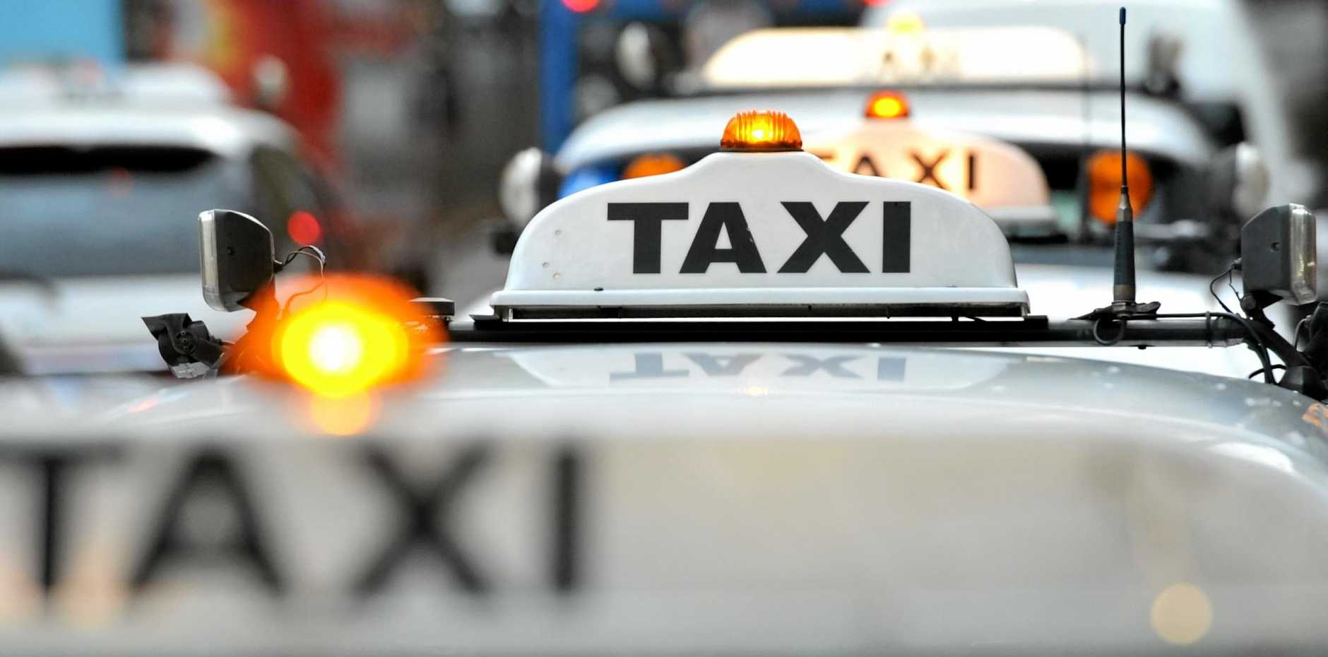 A taxi waits at a rank a