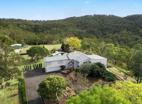 The $1.35m home is surrounded by 12.6 acres of bushland.