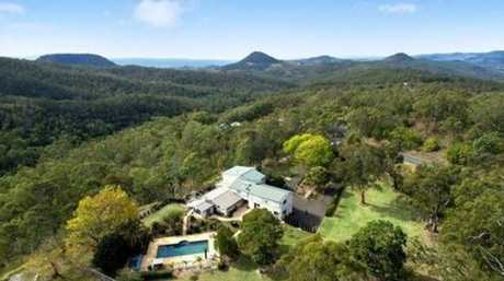 This Flagstone Creek Rd property includes a helicopter pad.