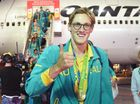 Australian Olympic team gold medalist Mack Horton is welcomed home from Rio de Janeiro on his return from the XXXI Summer Olympics, in Sydney (AAP Image/Paul Miller)