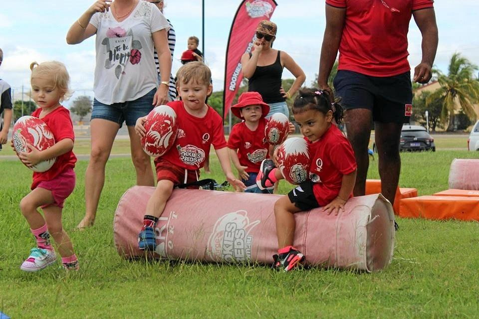 Darci Menzies, Ben Pilcher, Mathew Brazil and Kilani Uerata tackling the bag at the inaurgral clinic held in Bowen.