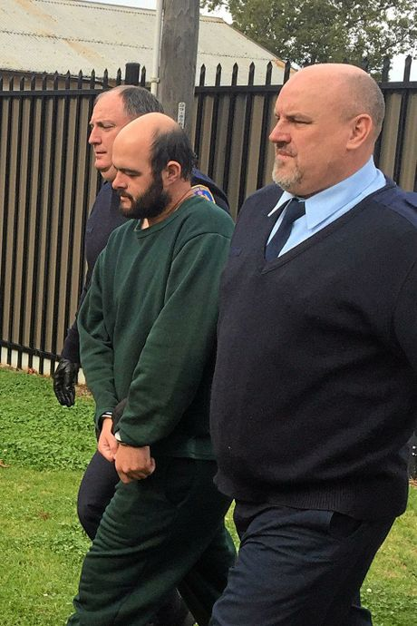 Marcus Stanford (centre) is escorted by police and corrections workers as he arrives at Leeton courthouse, Leeton, NSW, Wednesday, Aug. 24, 2016. Marcus Stanford, the twin of the man who murdered NSW teacher Stephanie Scott, has been jailed for at least one year and three months for helping his brother after the crime. (AAP Image/Andi Yu) NO ARCHIVING