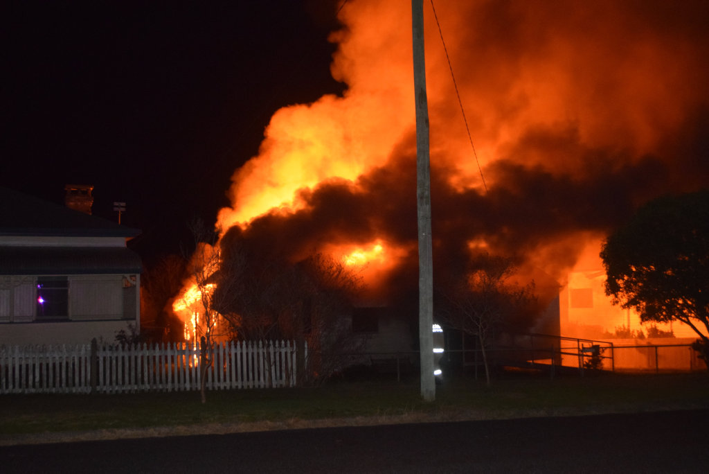 The house at 5 Wantley St, Warwick engulfed in flames.