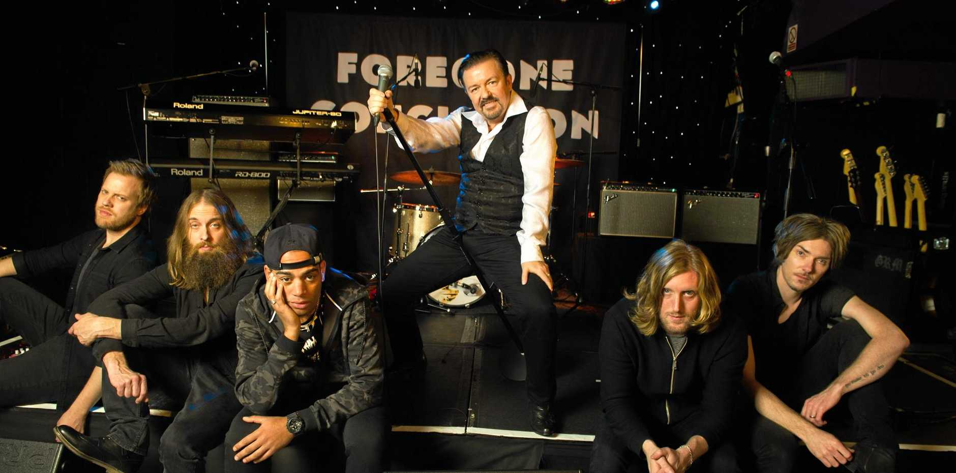 Ricky Gervais, Ben Bailey Smith and Foregone Conclusion (Steve Clarke, Andy Burrows, Stuart Baxter Wilkinson, Michael Clarke) in a scene from David Brent: Life on the Road.