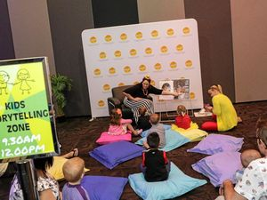 Wiggly children enjoy story time before the show