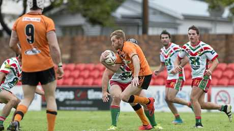 DANGER MAN: Souths winger Aaron Hooper goes on the attack against Pittsworth.