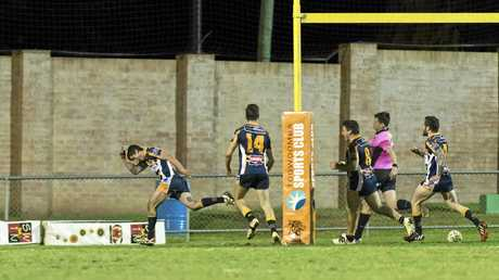 TRY TIME: Highfields player Steven Lee celebrates after scoring a try against Souths at Clive Berghofer Stadium.