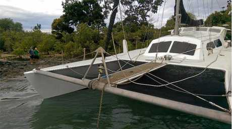STUCK IN THE...: The VMR Bundaberg crew helps a 10m ferro-cement yacht stuck in mangroves.