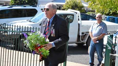 UNBROKEN: Vietnam Veteran Toby Trebilco lays a wreath in honour of his battalion at the Chinchilla Vietnam Veteran's Day service.