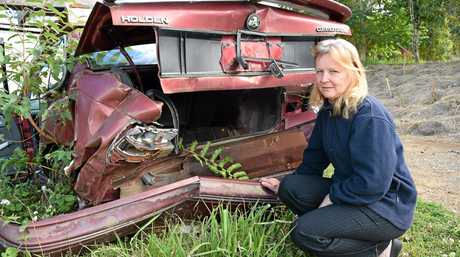 Eumundi resident Lyn Bayfield inspects the wreck of her car that was involved in a crash at the intersection of Eumundi Noosa Rd and Don Napier Rd in February 2012.