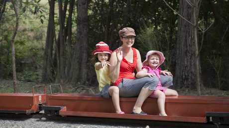 Anika and Cara Holzknecht (left to right) with their mother Melanie Foreman take a ride at Toowoomba Live Steamers.