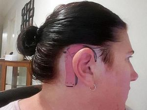 Mum gets tattoo to match 9yo daughter's cochlear implant
