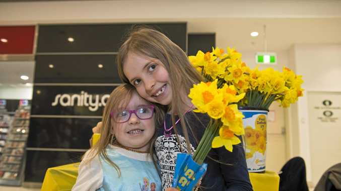 Sisters Grace Smith (left) and Hayleigh Wilkins with some daffodils for Daffodil Day, Friday, August 26, 2016.
