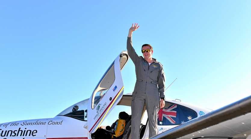 Lachlan Smart lands back on home soil at Sunshine Coast Airport setting a new world record.