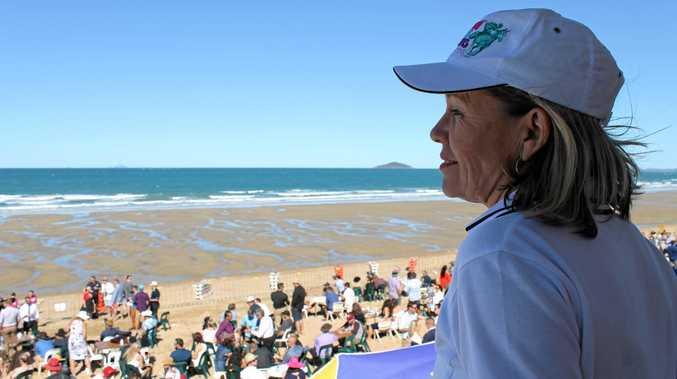 Mackay Beach Horse Racing Festival event organiser Chrissy Evangelou overlooks the festivities at Mackay Harbour Beach.