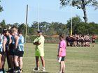 Pre-match huddle. Bay Power v Hervey Bay Bombers. AFL Wide Bay preliminary final at Coulthard Oval, Bundaberg.