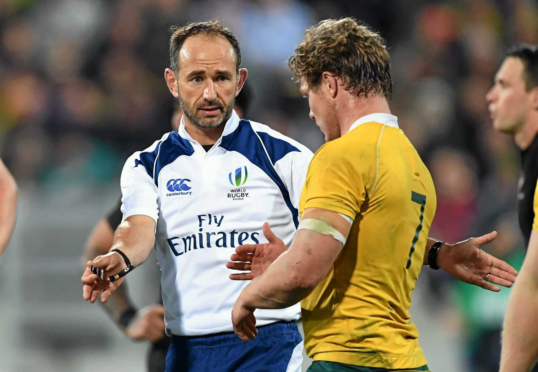 MAN IN THE MIDDLE: Referee Romain Poite warns Michael Hooper of scrum infringements   at Westpac Stadium.