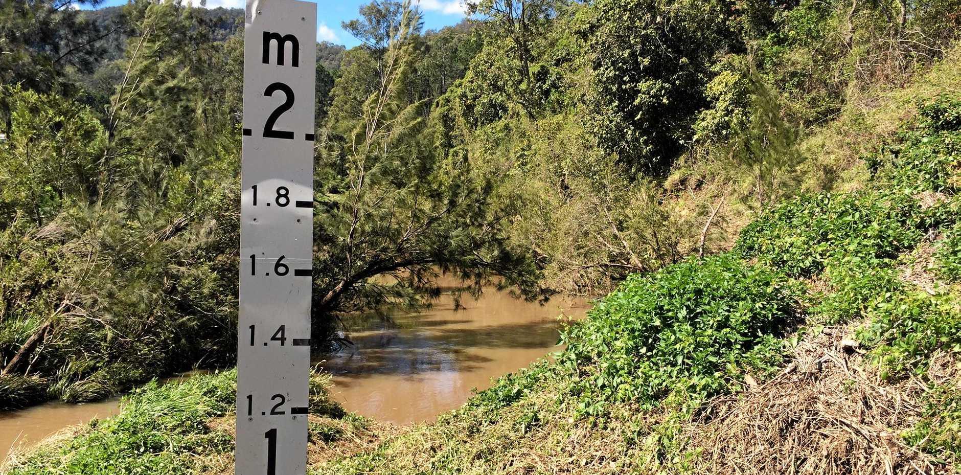 DANGER SIGN: A damaged flood sign at Martin Bridge .