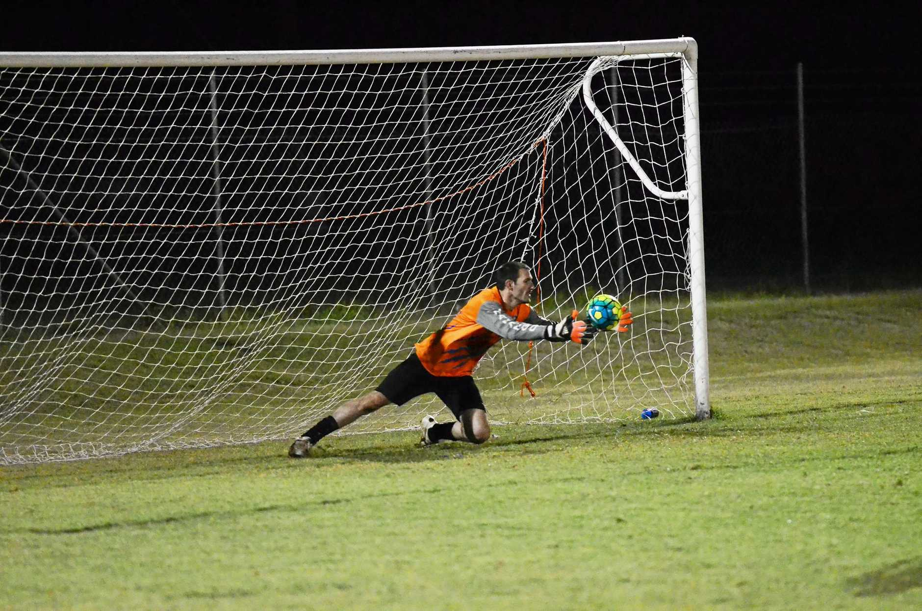 WINNING MOMENT: Nanango keeper Trevor Adams made a crucial penalty save which helped his side win the first division grand final on Saturday in Kingaroy.