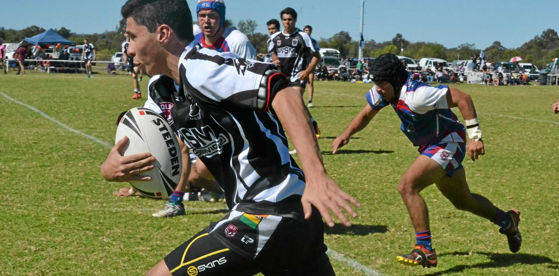 Roma Cities and Mitchell Magpies tussle for the title.