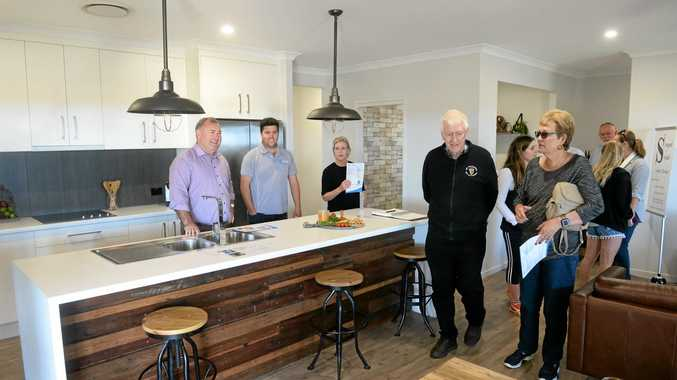 DISPLAY HOME: Jack Dempsey, Jesse Zielke, Leanne Donaldson and visitors at the JRZ display home in Belle Eden Estate.