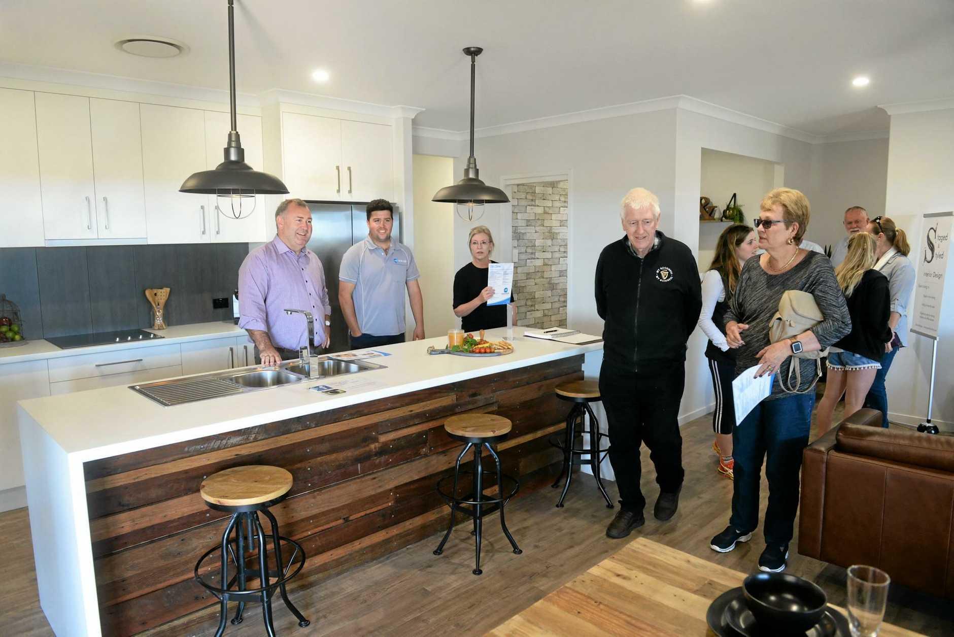 DISPLAY HOME: Jack Dempsey, Jesse Zielke, Leanne Donaldson and visitors at the JRZ display home in Belle Eden Estate.