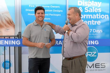 DISPLAY OF CONFIDENCE: JRZ Homes' Jesse Zielke and Mayor Jack Dempsey.