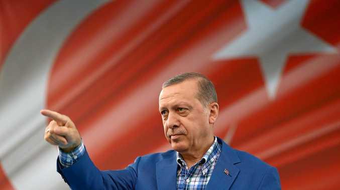 DETERMINED: Turkey's President Recep Tayyip Erdogan addresses a rally in Gaziantep, Turkey, on Sunday.