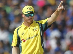 Warner guides Aussies to narrow win in first game in charge