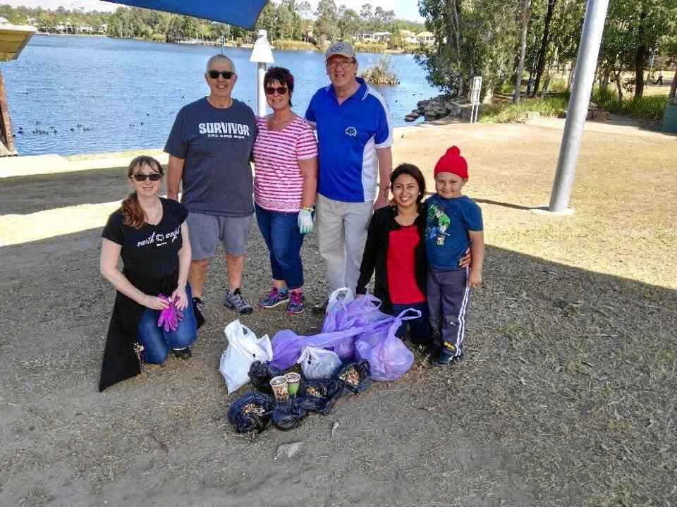 HELPING OUT: Volunteers of all ages with Cr Charles Strunk collect litter at Forest Lake.