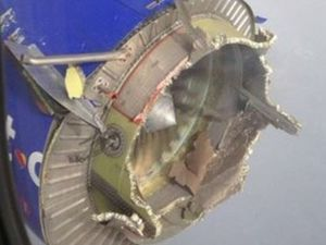 Passengers snap photos as plane's engine falls apart