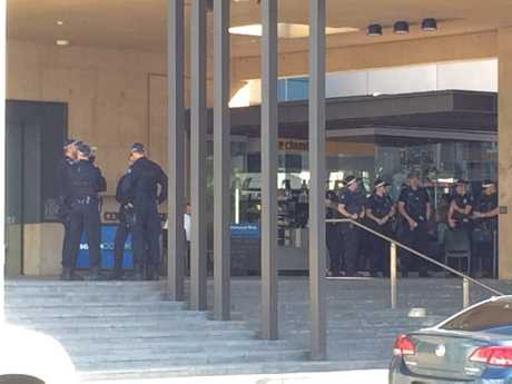 Police at Ipswich courthouse where protesters have turned out this morning for Tom Noble's sentencing.