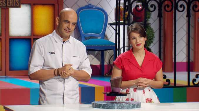 Adriano Zumbo and Rachel Khoo with Zumbo's floating dessert in a scene from Zumbo's Just Desserts.