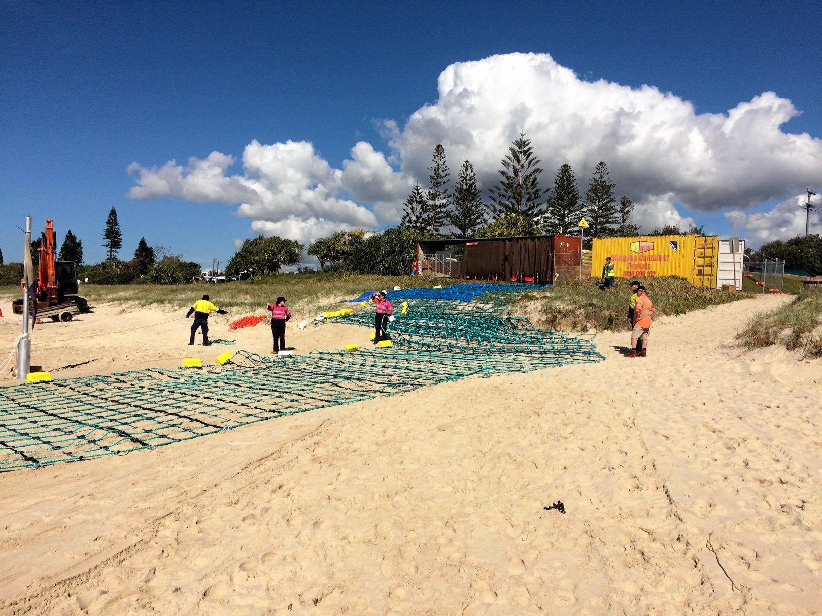Work has begun this morning to float the shark barrier into place at Lennox Head.