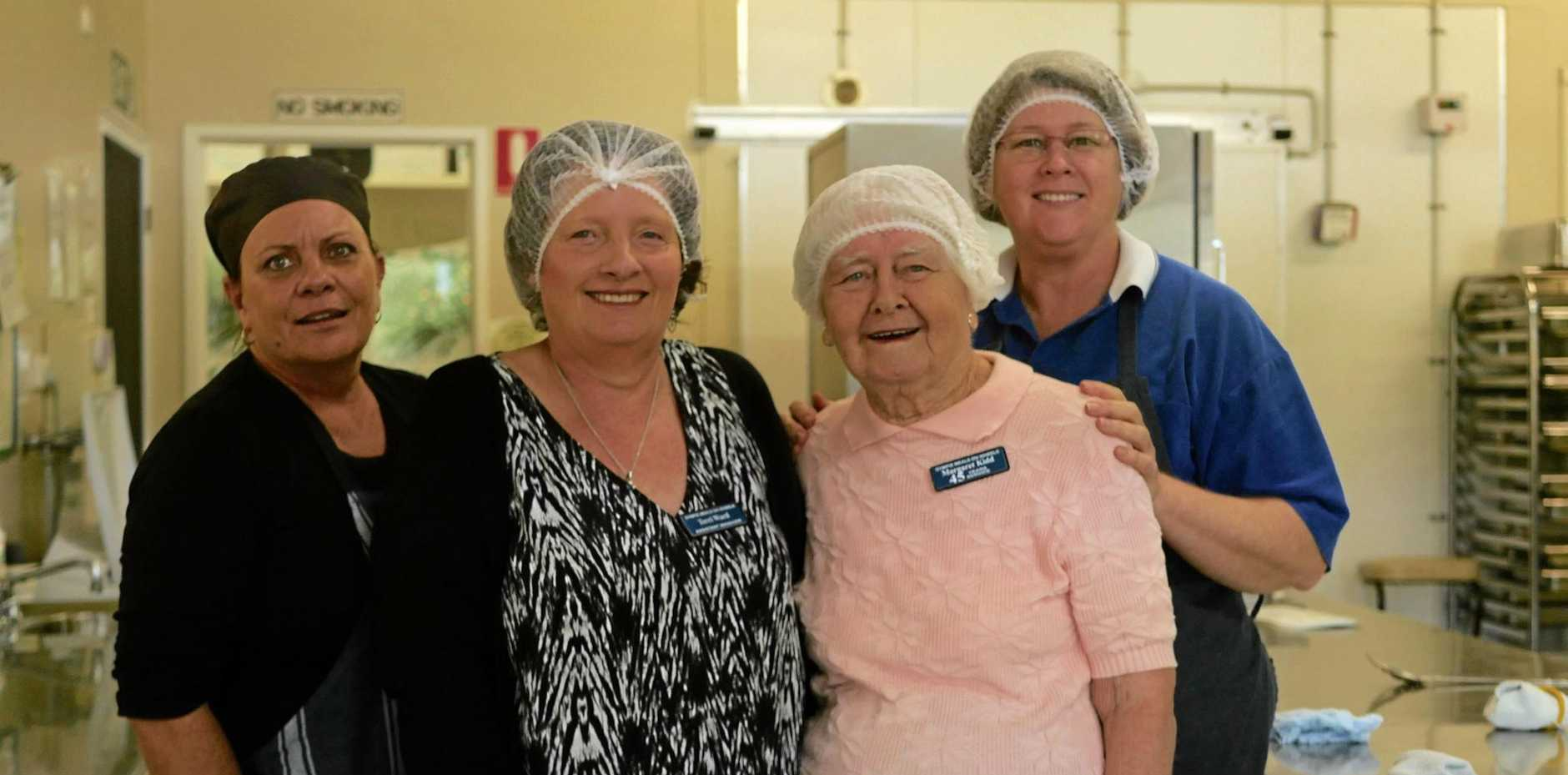 SERVING HELPING HAND: Barb Brook, Terri Ward, Margaret Kidd and Dianne Wood pitch in at the Gympie Meals on Wheels centre.