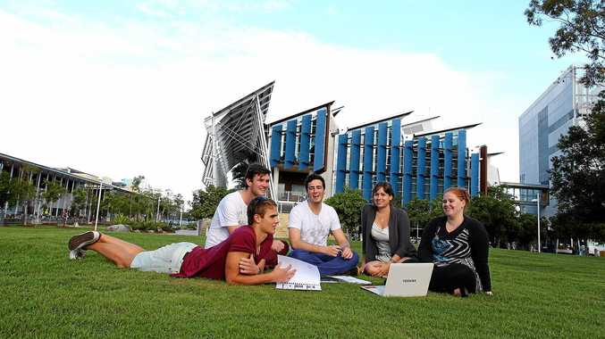 University of the Sunshine Coast students relax on the Sippy Downs campus. The lack of an on-campus bar has left many with a lack of entertainment options.