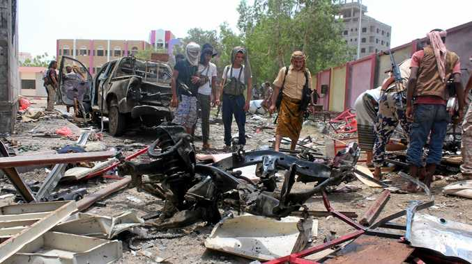 epa05513955 Yemenis inspect the site of a suicide bombing targeting a recruitment center in the southern port city of Aden, Yemen, 29 August 2016. According to reports, at least 60 people were killed by an Islamic State (IS) suicide bomber who drove an explosive car into a recruitment center run by pro-government militias in the southern Yemeni city of Aden.  EPA/STR