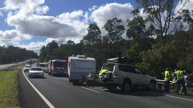 A car towing a caravan has crashed. Photo: Clayton's Towing.