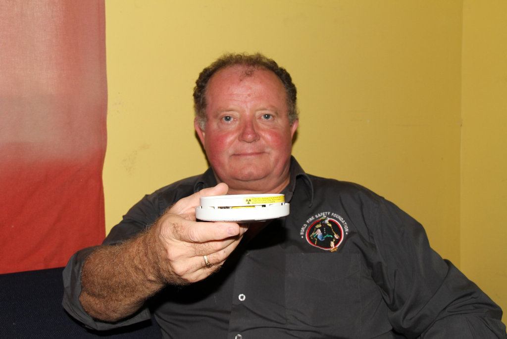 CHECK THIS: World Fire Safety Foundation chairman Adrian Butler shows the radioactive tag present on and inside the inferior ionisation smoke alarms. Photo Rodney Stevens / Daily Examiner