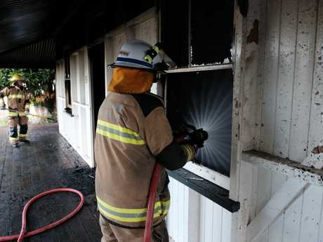 Firefighters were still putting out the last embers of the fire around 6.45am on Glasson St, Chinchilla, this morning.
