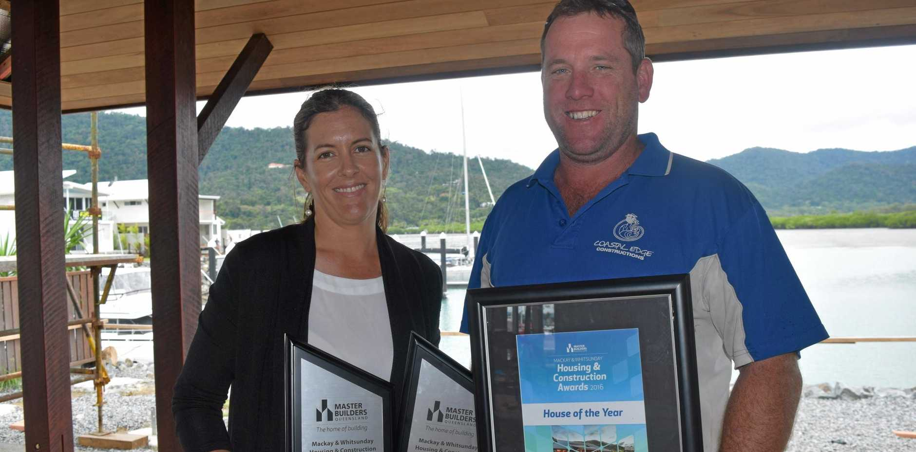 HARD WORK: Jodie and Ben Ferdinand with their awards at their home at The Cove.