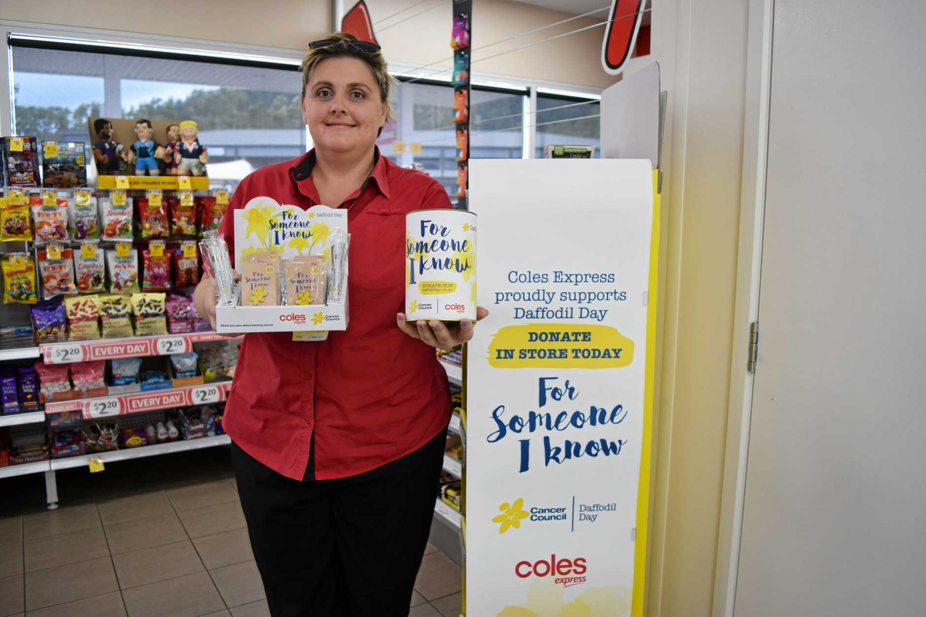 CLOSE TO HOME: Coles Express Cannonvale manager Rachel Jensen has her own reasons for getting behind Daffodil Day.