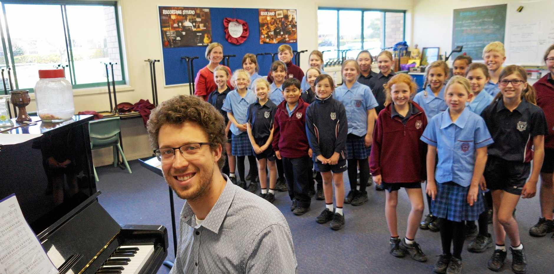 Musician Michael Bradshaw visits the schoolkids of Roma to help with their upcoming eisteddfod.