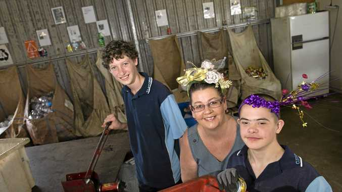 CELEBRATION: Clifford Park Special School student Harrison Gardner (left) joins Braydon Daly and mum Kim at the recycling centre ahead of the silver anniversary celebrations.