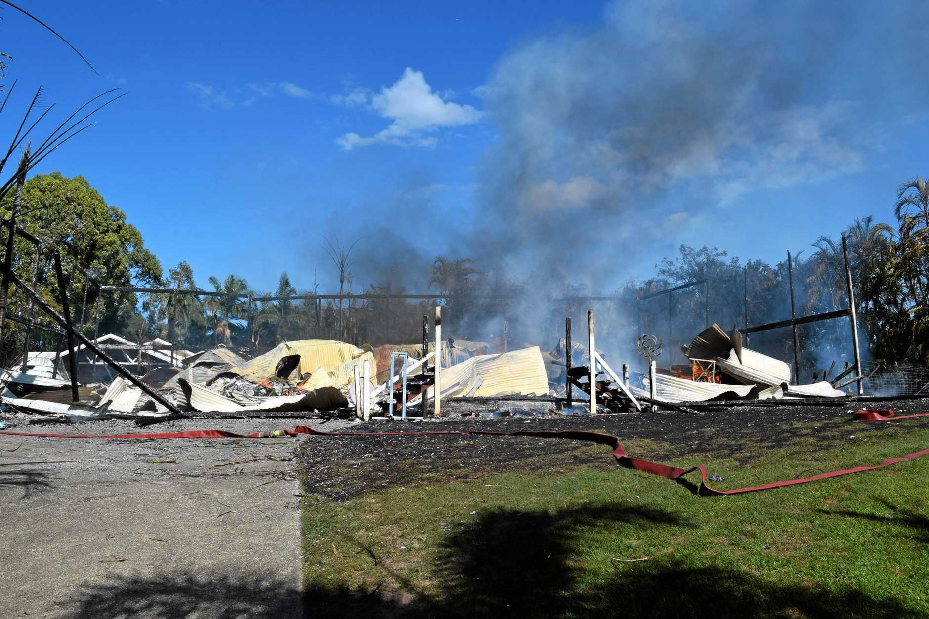 SMOULDERING: A house fire demolished a Queenslander at Peregian.