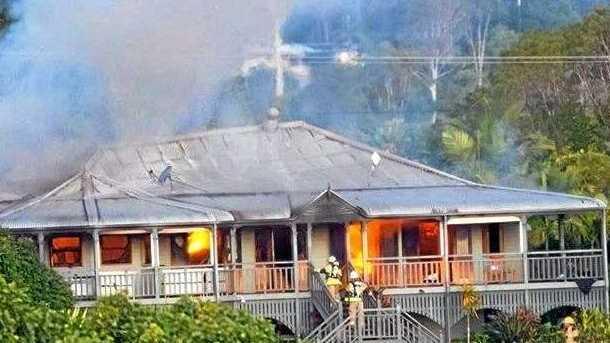 ABLAZE: Firies battle a devastating house fire at Eumundi.
