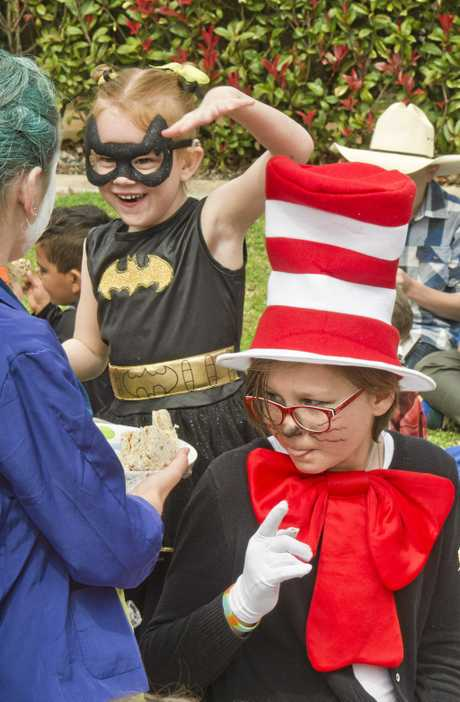 CAT AND A BAT: Chelsea Bressington (left), 5, and Jordan Russell, 12, enjoy National Literacy and Numeracy Week at Wilsonton State School.