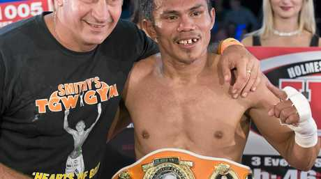 SUCCESSFUL PARTNERSHIP: Brendon Smith (left) with Jack Asis after Jack's defeat of Waylon Law for the first Brayd Smith World United Championship belt at Rumours International on May 13.