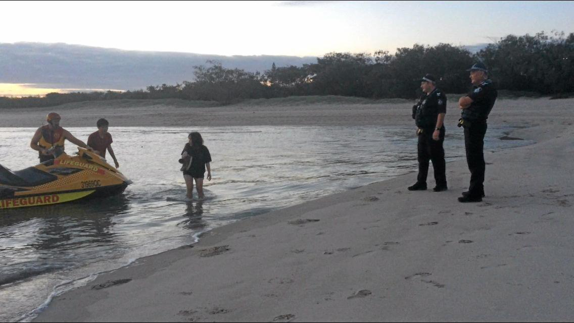 LUCKY ESCAPE: Two of the rescuees come ashore at Elliott Heads. Photo: Eliza Goetze / NewsMail