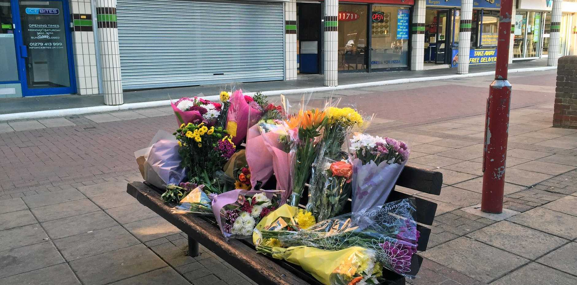 Flowers are placed near the scene of an attack that resulted in the death of a Polish man, in Harlow, England, Tuesday, Aug. 30, 2016. British police have arrested six teenagers suspected of murdering a Polish man in a possible hate crime, according to police and local media. Essex police said in a statement Tuesday that four 15-year-old boys and one 16-year-old boy from the town of Harlow, 50 kilometers (30 miles) north of London, were arrested Monday on suspicion of murder. They were later released on bail pending further inquiries until Oct. 7. (AP Photo/Derl McCrudden)